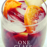 A vibrant glass of red sangria garnished with fruit