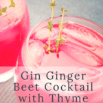 A vibrantly pink cocktail on the rocks with sprigs of thyme
