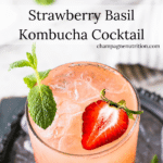 a gorgeous shot of this vibrant kombucha cocktail with bright berries and basil on ice