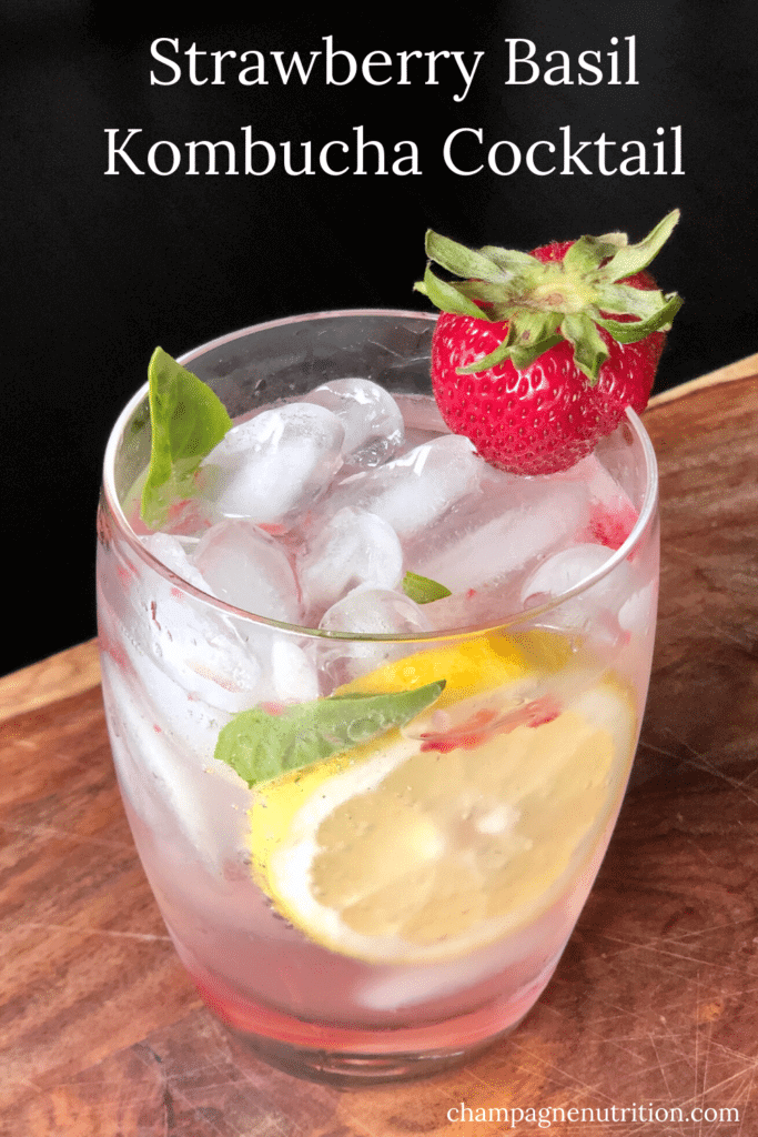 a gorgeous shot of this vibrant kombucha cocktail with bright berries and lemons on ice