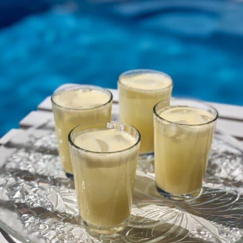 creamy orange cocktails by the pool