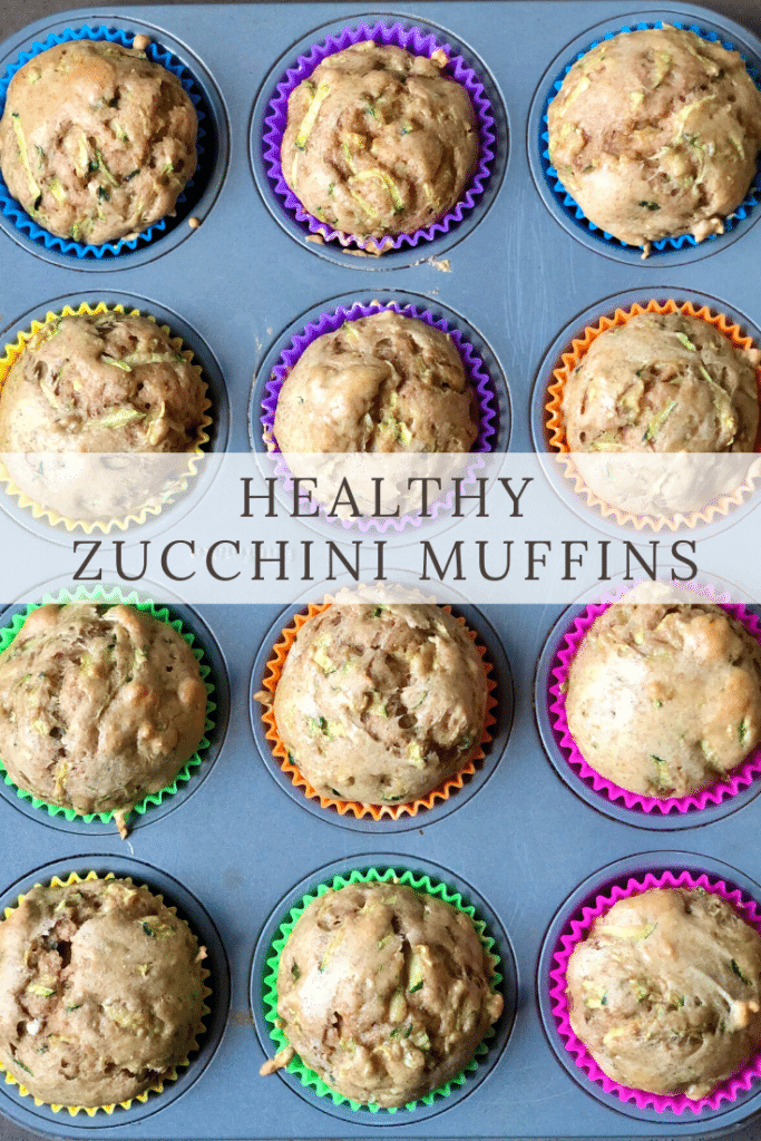 Zucchini muffins in a 12-tin with brightly colored liners