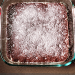 perfectly baked brownies with powdered sugar on top