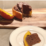 A slice of delicious chocolate cake within a baked pumpkin